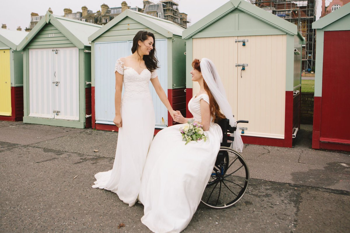 Jessica and Claudia in their wedding dresses