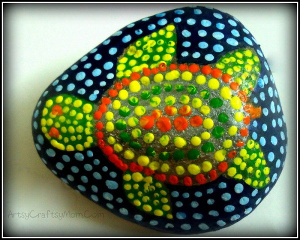 Australian aboriginal art on a river pebble