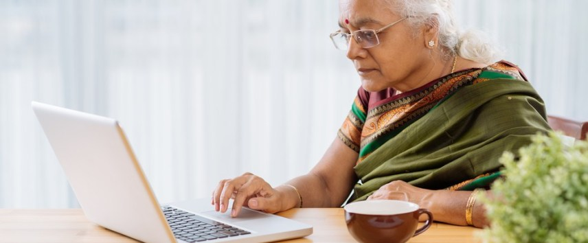 elderly Indian woman with a laptop
