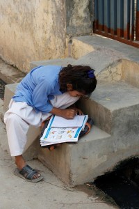 A Pakistani girl doing schoolwork