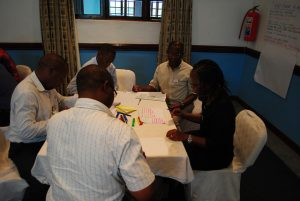 Executives from NBS Bank in discussion at the Senior Management Training Program