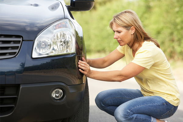 Should you wait for a mechanic or handle a flat tire car yourself