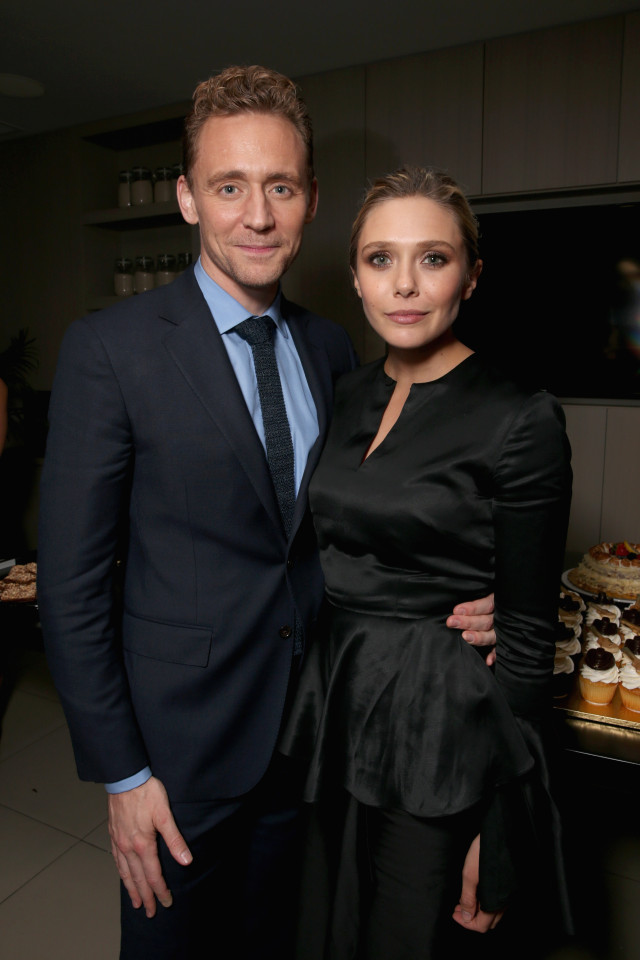"TORONTO, ON - SEPTEMBER 11: Actors Tom Hiddleston (L) and Elizabeth Olsen attend Sony Pictures Classics after party for ""I Saw The Light"" sponsored by Lacoste and Ciroc at The Addison Residence on September 11, 2015 in Toronto, Canada. (Photo by Todd Williamson/Getty Images for Sony Pictures Classics)"