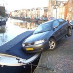 car on small boat