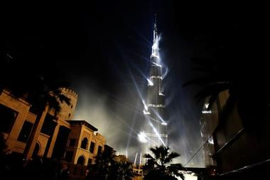 Burj Dubai tower, the world's tallest skyscraper, is lit by laser lights during its opening ceremony in Dubai