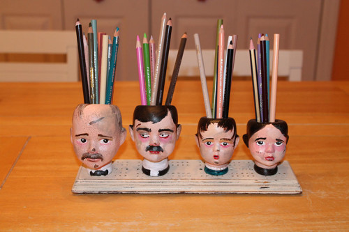 Heads on Board with Pencils