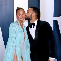 Chrissy Teigen and John Legend kiss