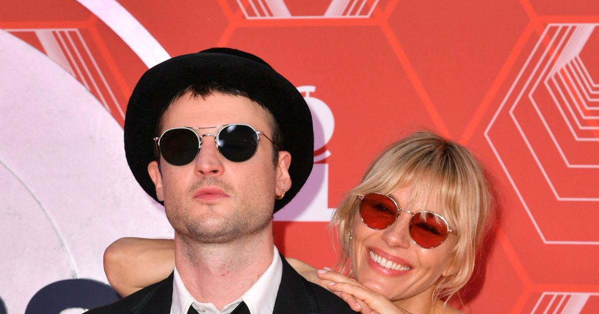 Exes Sienna Miller and Tom Sturridge pose together, more stars on the 2021 Tony Awards red carpet.jpg
