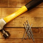14842959 – hammer and nails on wood