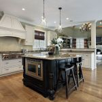 14976229 – kitchen in luxury home with white cabinetry