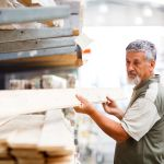 18609494 – senior man buying construction wood in a  diy store