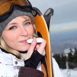 24083404 – attractive skier applying lip balm