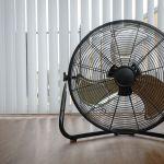 53210778 – black metal ventilation fan on wooden floor