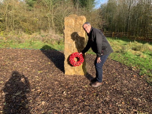 Paul Blackwell laying a wreath at the Mmemorial Stone