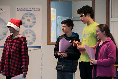 Middle School students wait to sing.