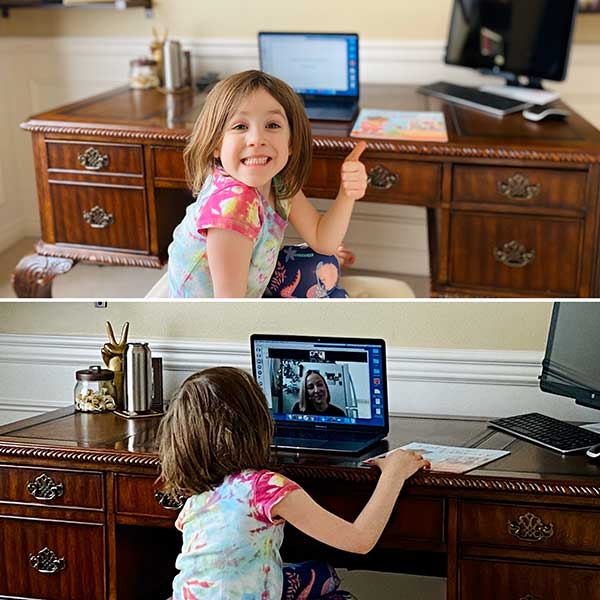 A girl gives a thumbs up to seeing her teacher via Zoom