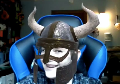 A student in a virtual horned helmet