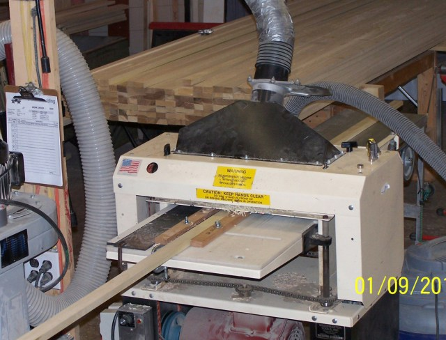 Here's the Perkins' Woodmaster 718 set up to run molding. They buy stock precut to size and run it through their Woodmasters to mold it to their customers' spec.