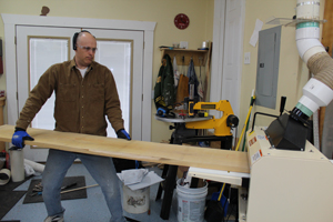 Paul tests the Woodmaster's planing function by running a huge maple plank through.