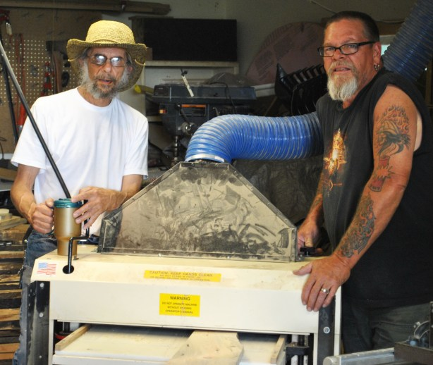 Jim and his buddy, Daren Pautzke (right) put miles of oak through Jim's Woodmaster Molder/Paner, creating flooring and molding during the restoration of Jim and Lynn's Victorian home.
