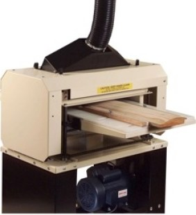 "Kim has owned his Woodmaster Molder/Planer for 25 years. He added the Spiral Cutterhead, shown here, and reports it creates a finish that is ""literally as smooth as glass, even on very hard woods like walnut."
