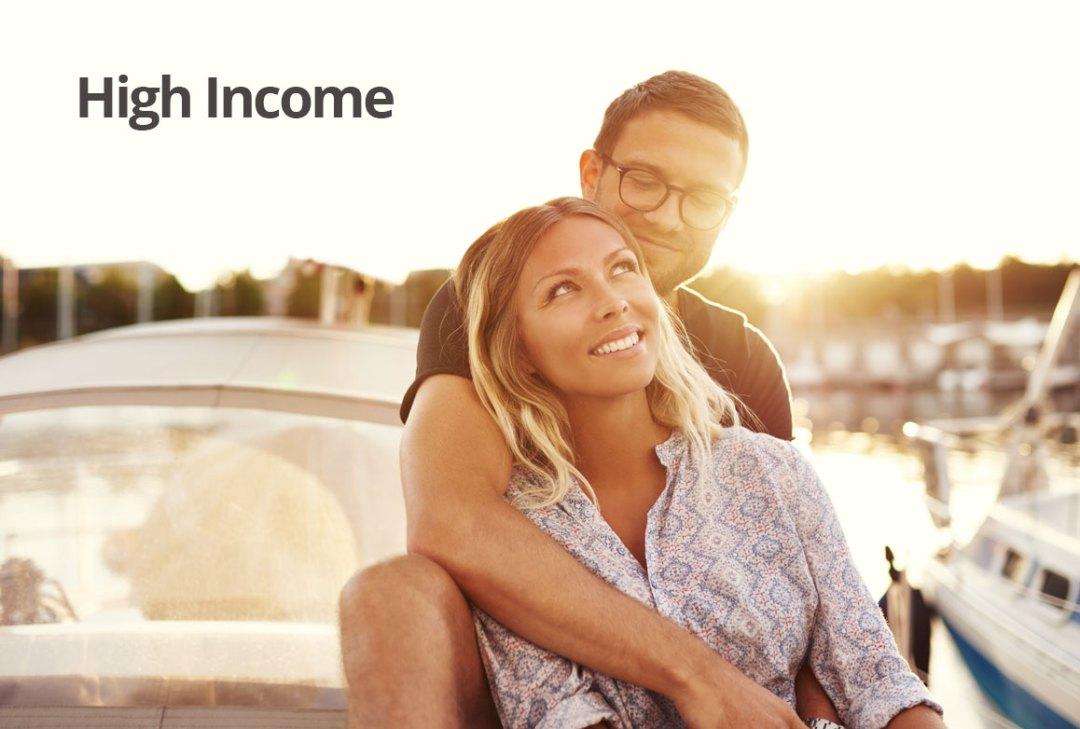 Financial advice for high income earners - couple next to a marina