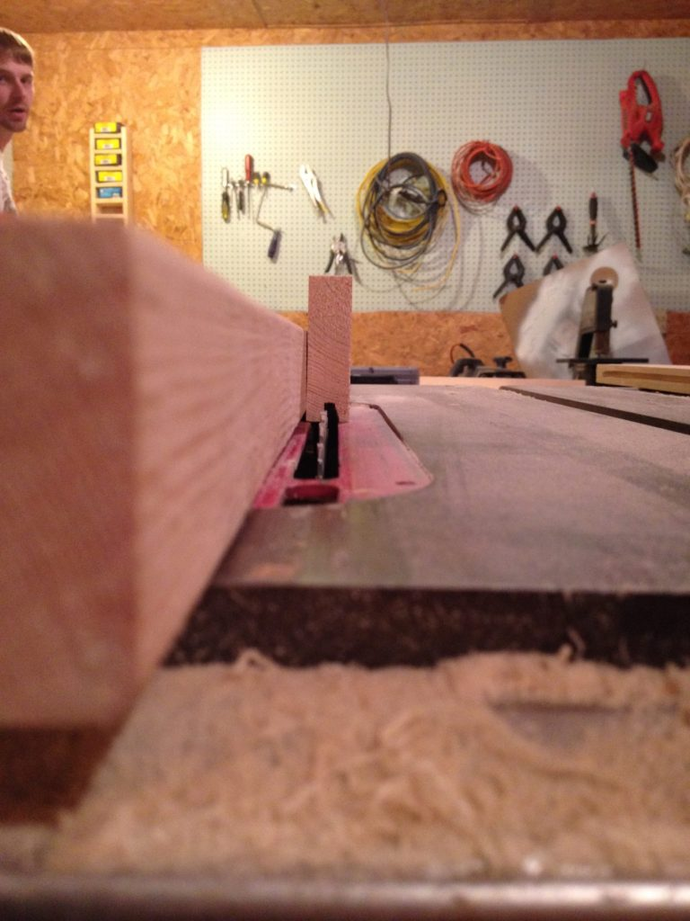 Rip fence on table saw set to 1/4 inch from the blade to cut dadoes into cabinet door frame