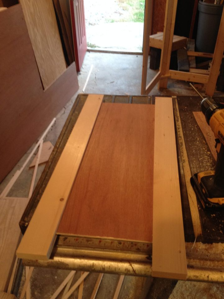 Shaker cabinet doors dry fit into side frame dadoes