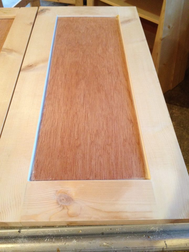 front of shaker cabinet doors caulked between inside panel and outside frames