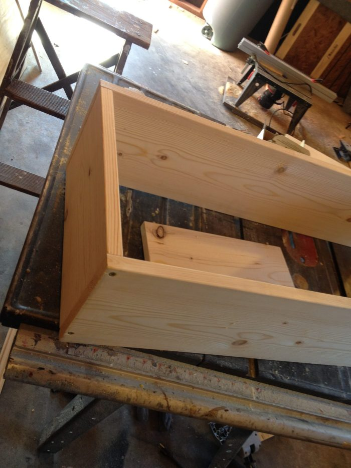 """Two 28"""" boards screwed into 10"""" board to make long side of floating corner shelf"""