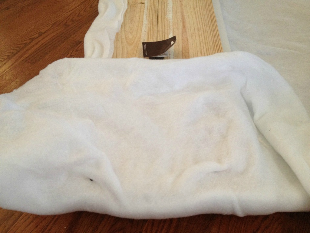 Batting tacked over sides of upholstered bench seat