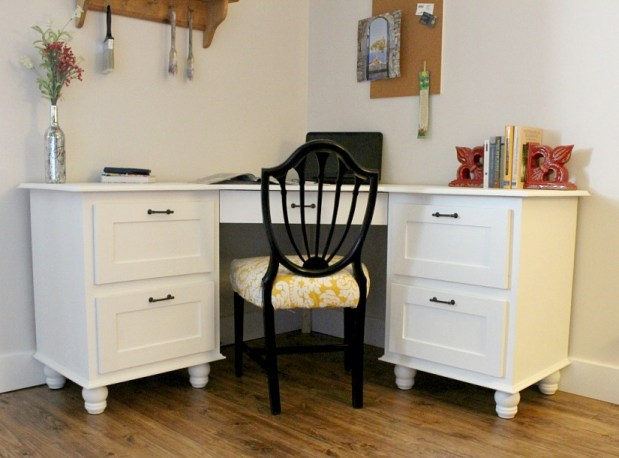 Finished DIY corner desk painted white in corner of office space with black chair