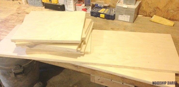 Boards cut stacked and ready to assemble tall linen shelf