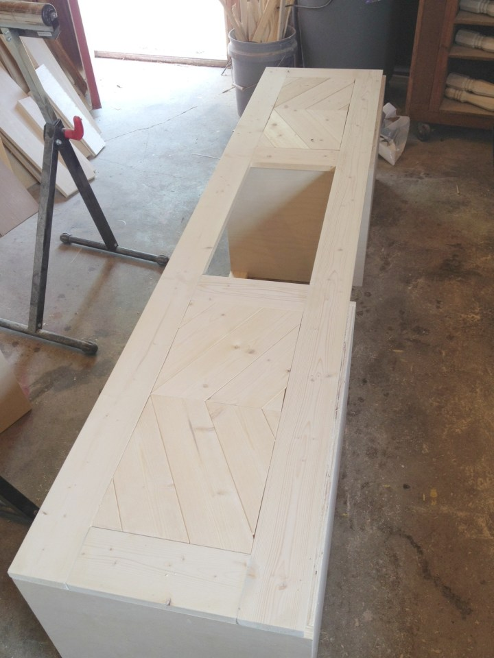 Chevron wood cut outs added to built in shoe bench fronts