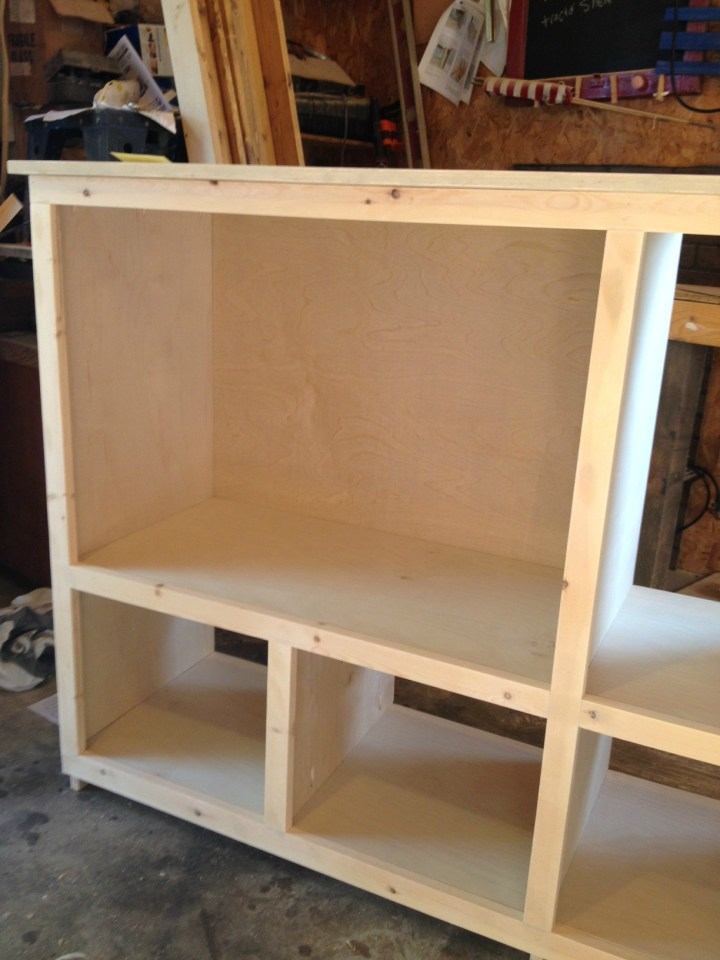 Face frame nailed in place on diy storage console cabinet