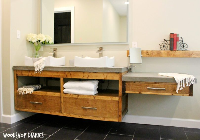 Free building plans to make your own modern DIY Floating bathroom vanity. Plenty of storage, clean straight lines and stained in Minwax Provincial, this gorgeous bathroom vanity will really make a statement in any DIY Bathroom remodel!