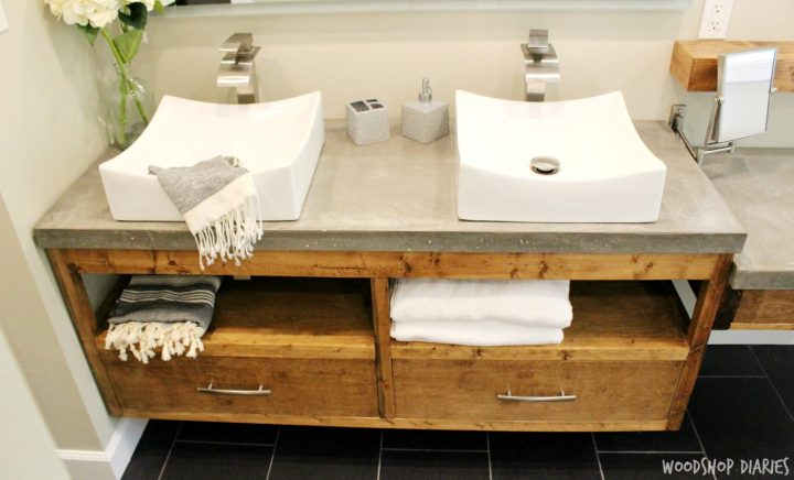 DIY Floating bathroom vanity with concrete countertops and vessel sink. Clean modern style bathroom