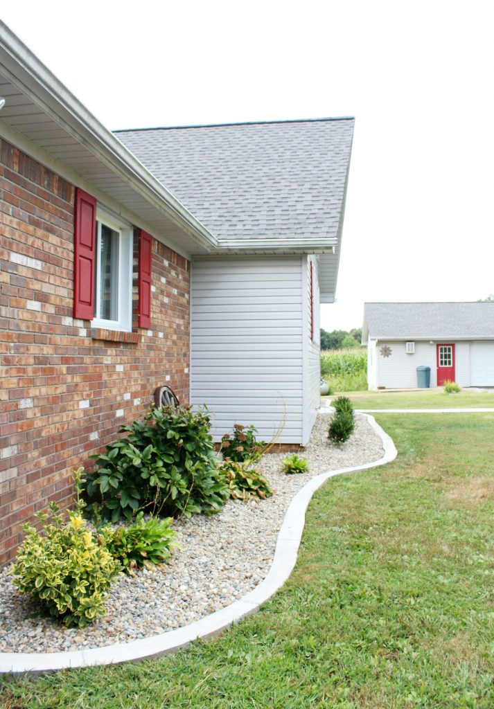 Modern landscape with concrete edging and Indiana river rock really improves home's curb appeal