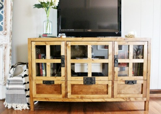 How to build your own DIY display media console cabinet and tv stand with drawer storage and glass panel doors! Get the free building plans here