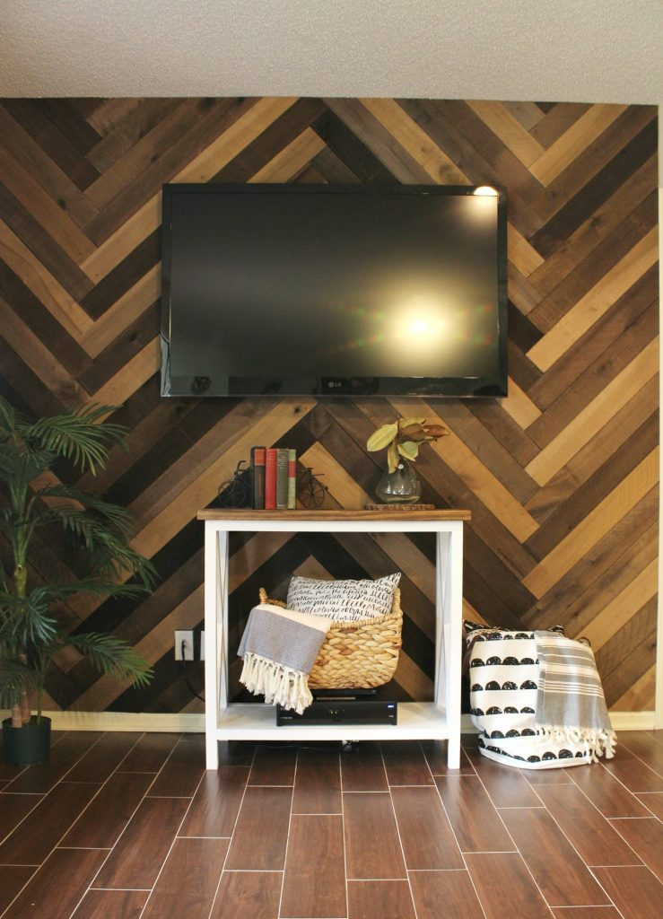 How to install a barn wood wall in a herringbone pattern. Gorgeous accent wall and it's so easy to do!