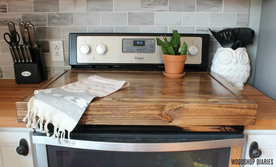 DIY Wooden stove top cover sitting on stove for extra counter space