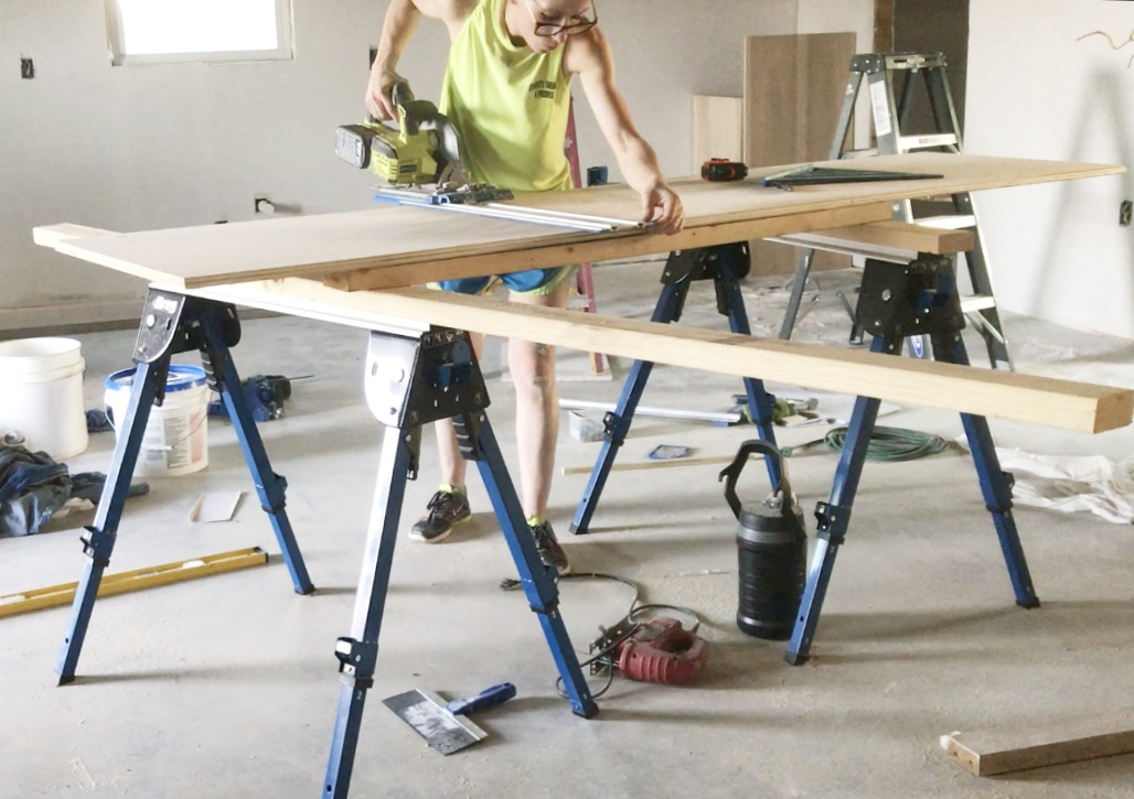 Plywood set on saw horses for easy cutting with circular saw