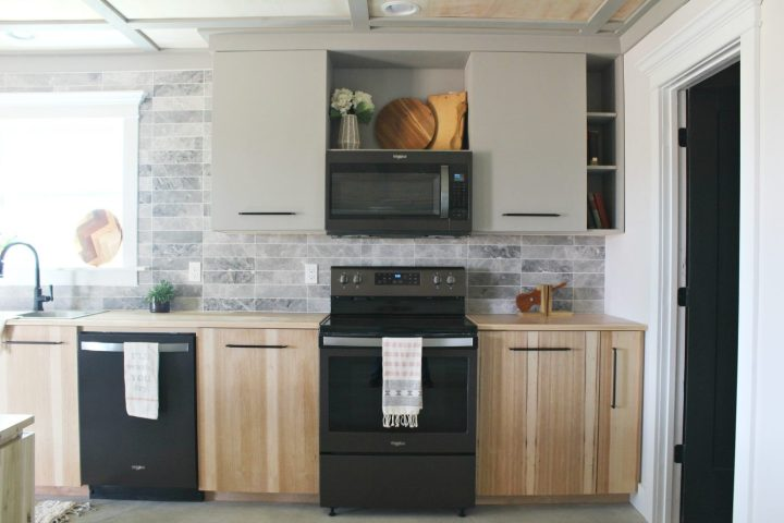 Modern kitchen cabinets installed with black stainless appliances