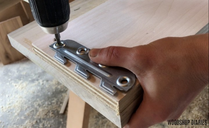 Install teeth part of bracket into modern bed rails