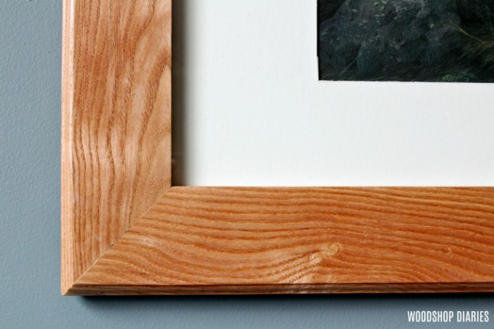 Close up of mitered corners and decorative edges of DIY custom picture frame