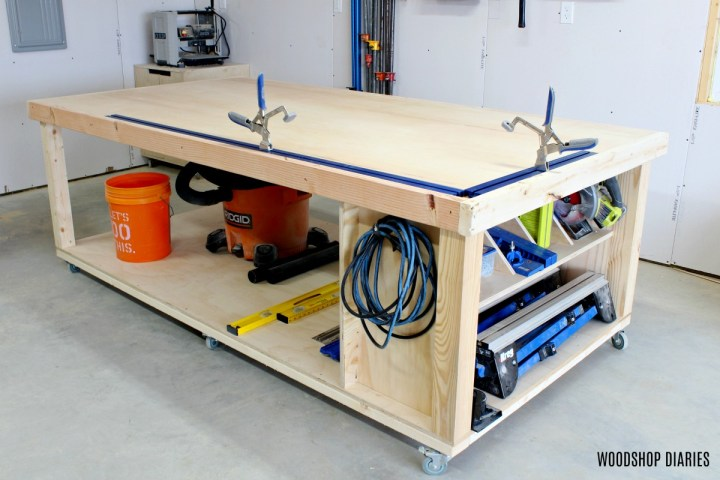 Finished DIY plywood top mobile workbench with clamp tracks installed