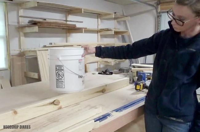 2x4 as wooden base of DIY concrete planter pot