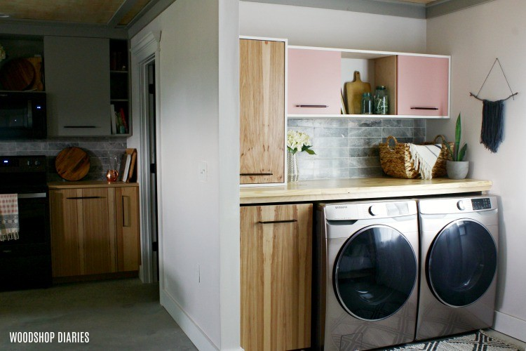 Laundry room adjacent to kitchen matching hickory plywood doors