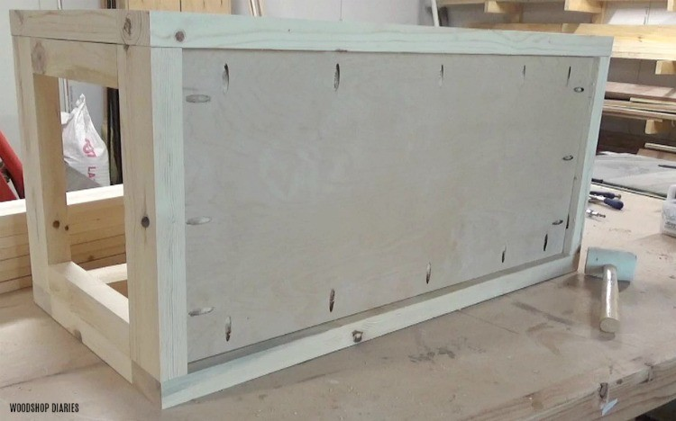 Plywood bottom installed using pocket holes and screws into 2x4 hope chest frame