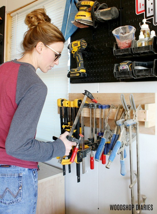Shara Woodshop Diaries hanging clamps on DIY clamp rack storage system